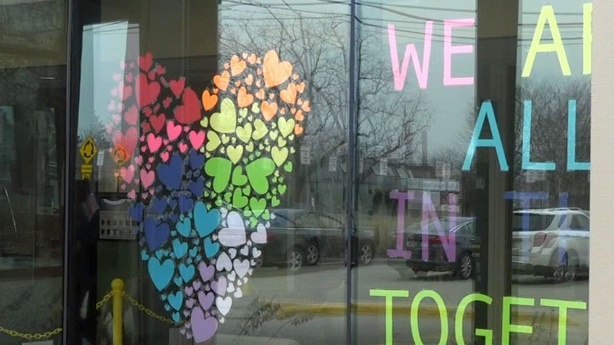 "A display of paper hearts with the message ""We are all in this together"" is hung in a window at UnityPoint-Finley Hospital in Dubuque on Wednesday, March 25, 2020 (Fernando Garcia-Franceschini/KCRG)"