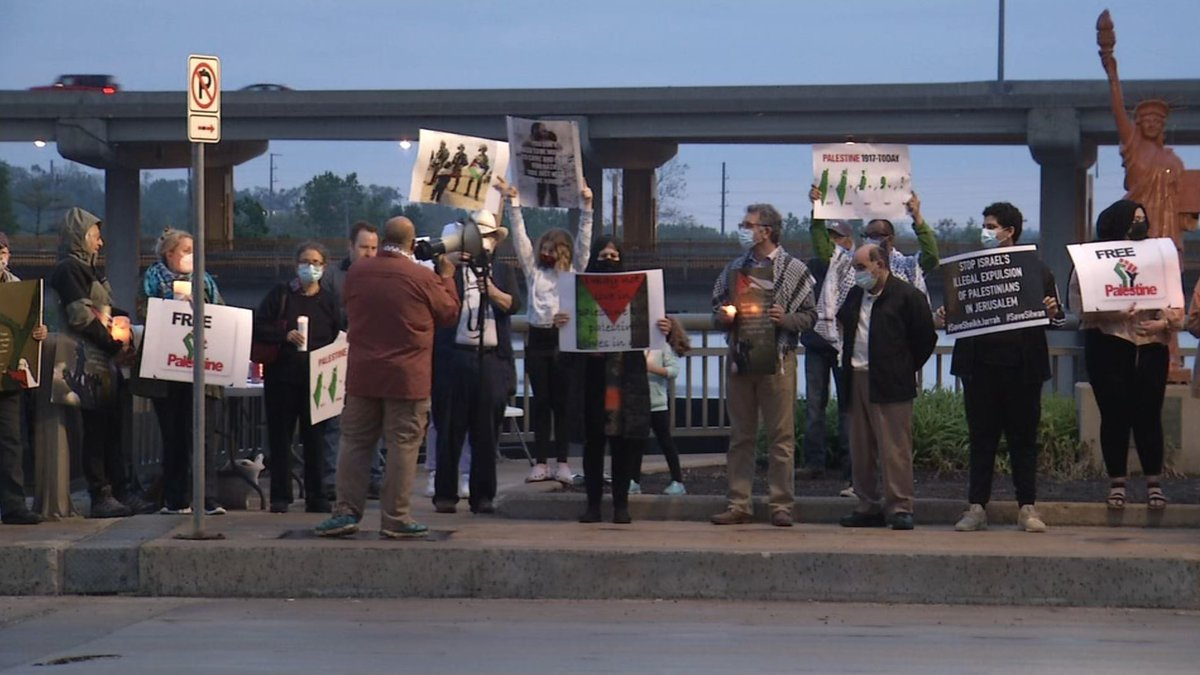 People attend a candlelight vigil in support of Palestine on Sunday, May 16, in Cedar Rapids.