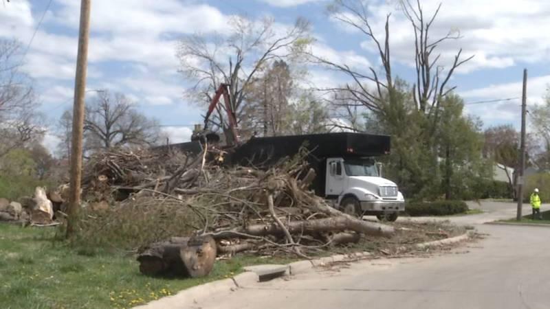 A Flannery crew clears debris in southeast Cedar Rapids in April 2021.