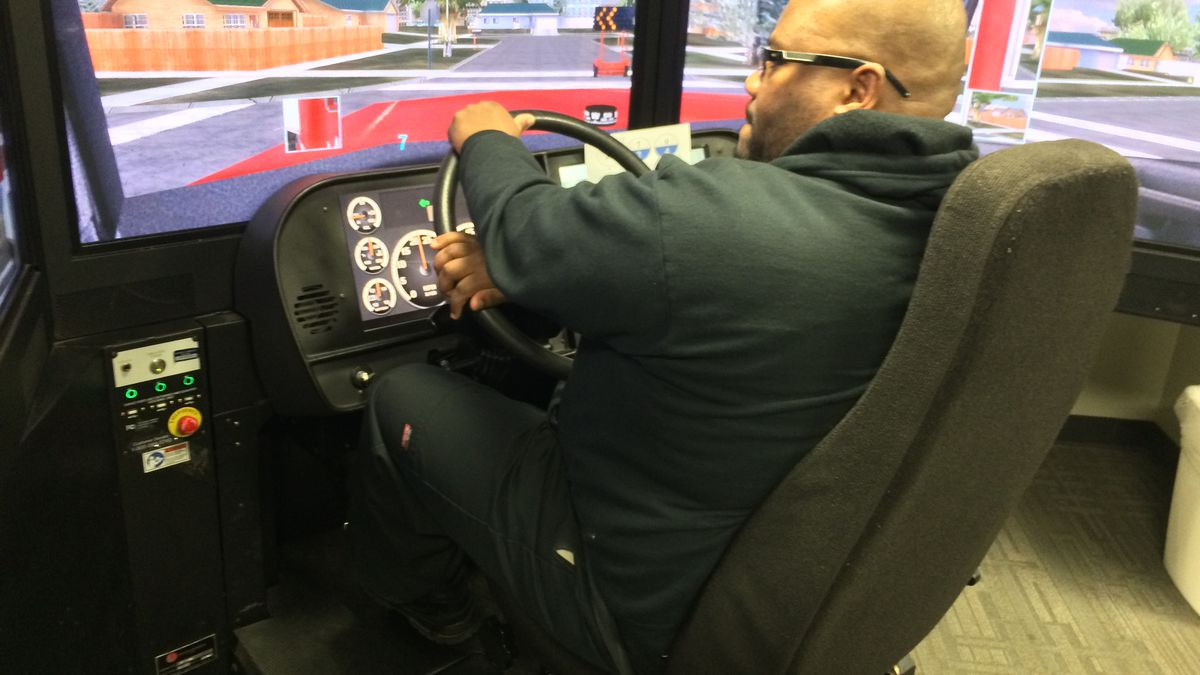 Herson Arzu uses a driving simulator at the Hawkeye Community College Regional Transportation Training Center.  The center recently got a federal grant to provide free training to become a truck driver for veterans or their family members.