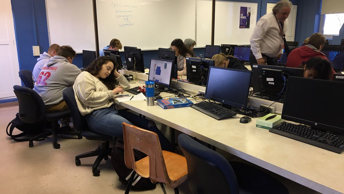 Kids work in a financial literacy course at Dubuque Senior High School on Wednesday, Oct. 24,...
