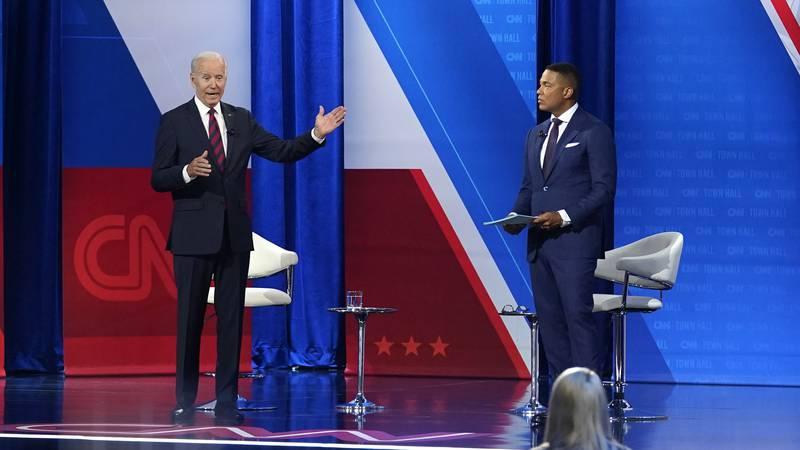 President Joe Biden, accompanied by CNN journalist Don Lemon, right, speaks at CNN town hall at...