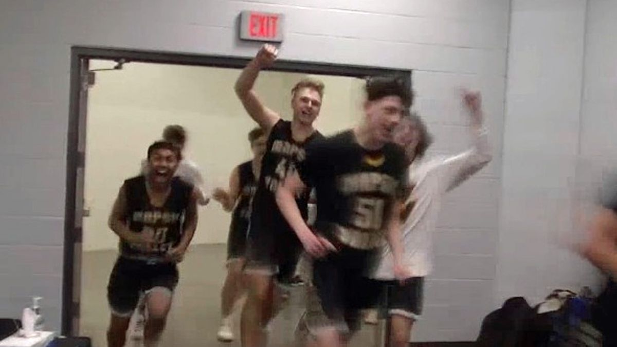 Players for the Wapsie Valley High School boy's basketball team celebrate while returning to the locker room following a 49-45 win against top-seeded Lake Mills in the Class 1A state basketball tournament quarterfinals on Monday, March 9, 2020. (John Campbell/KCRG)