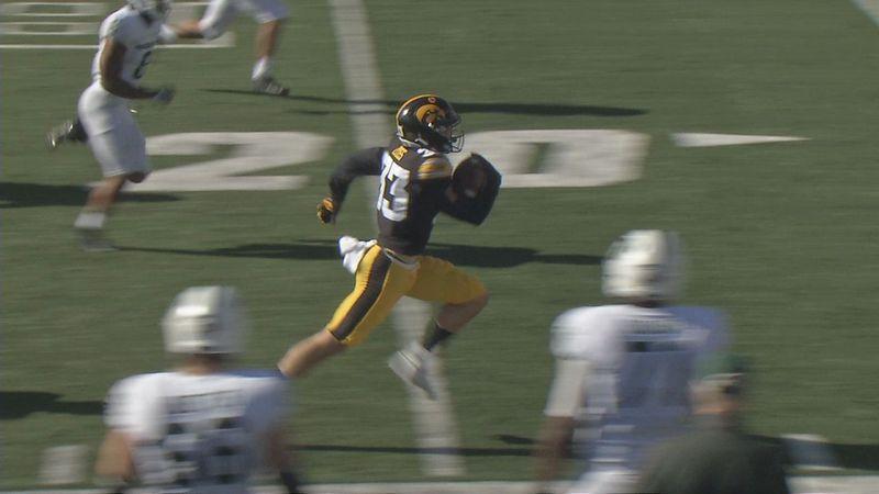 Riley Moss returns an interception 54 yards for a touchdown in Saturday's 49-7 victory against...