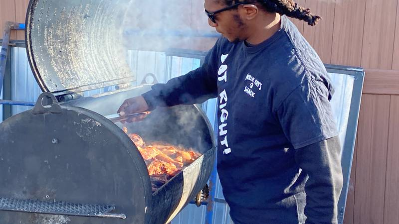 Willie Ray Fairley preparing food for his business Willie Ray's Q Shack