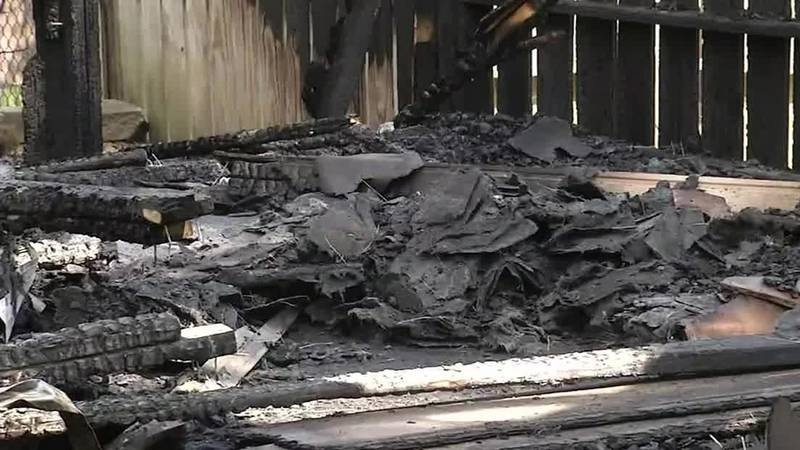 Charred rubble lays on the ground after a shed in Cedar Rapids caught fire over the holiday...