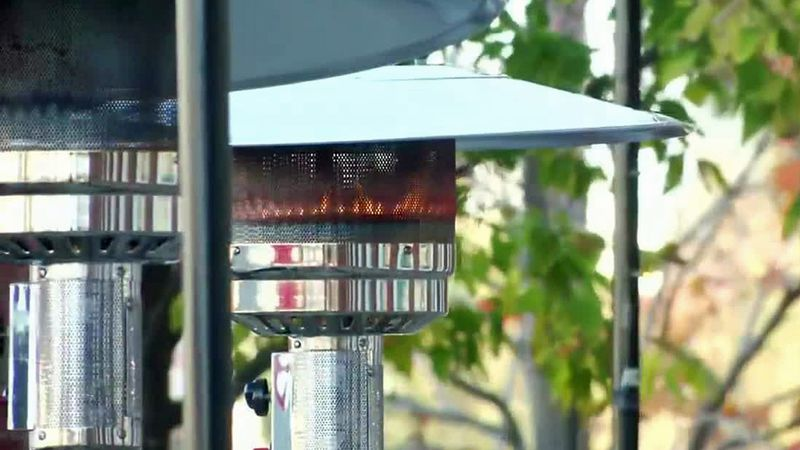An outdoor heater on a patio.