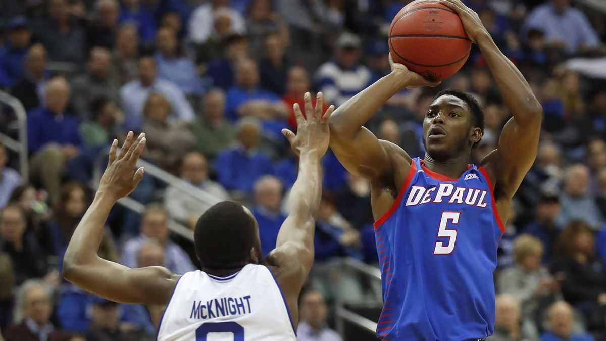 DePaul's Jalen Coleman-Lands (5) takes a jump shot against Seton Hall's Quincy McKnight (0)...