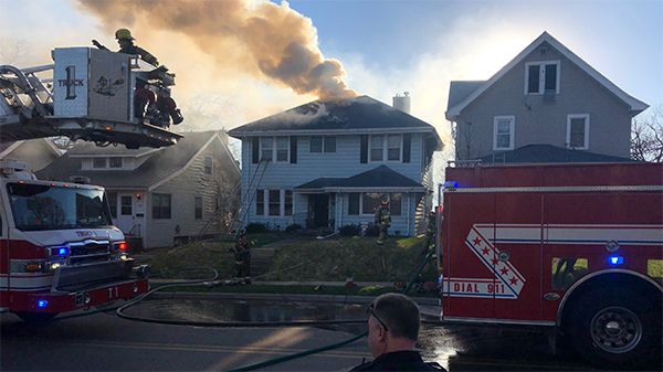 Crews respond to a house fire in the 900 block of Oakland Road Northeast on Friday, April 19, 2019. (FORREST SAUNDERS/KCRG)