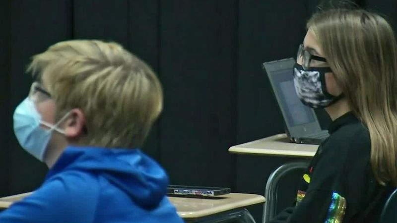 Students at a school in Bellevue wear masks during classes amid the ongoing novel coronavirus...