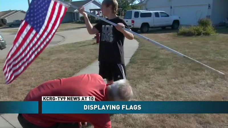 Flags being put up over Labor Day weekend for essential workers