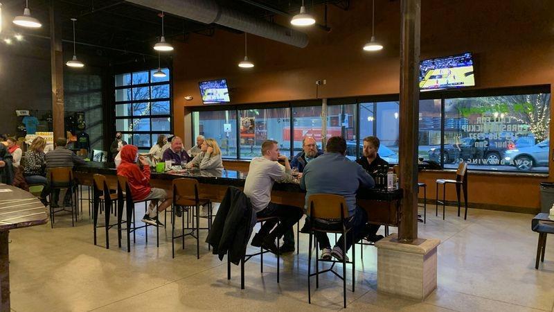 Customers sit in Iowa Brewing Company's taproom in Cedar Rapids on Nov. 25, 2020.