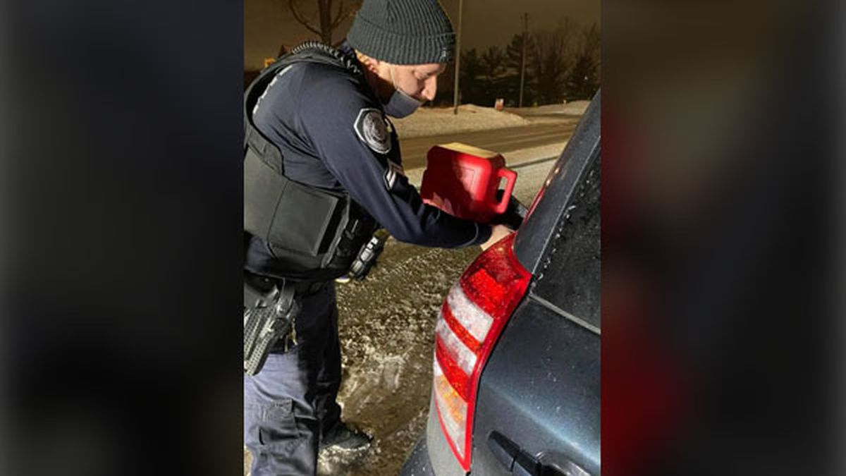 A Johnston police officer brought gasoline to get a motorist's vehicle moving again on Wednesday.