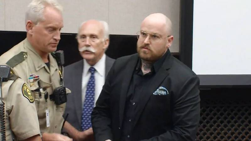 Drew Blahnik is escorted out of Linn County Court with his attorney after being convicted of...