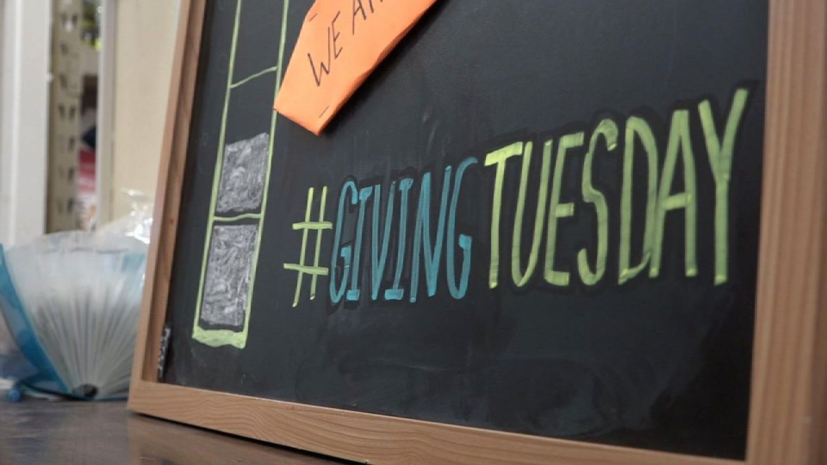A chalkboard is displayed at the North Liberty Community Pantry on Tuesday, Dec. 3, 2019 for Giving Tuesday (Aaron Scheinblum/KCRG)