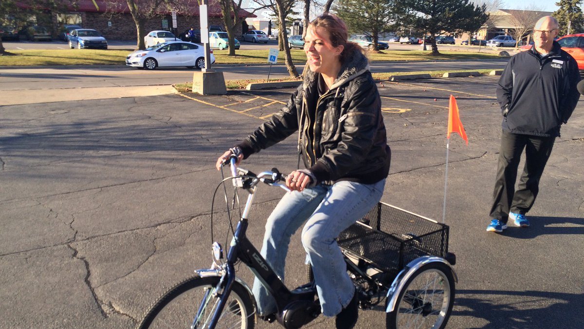 Bridget Kuhlman checks out her new ride in a parking lot.  The disabled Cedar Rapids woman had...