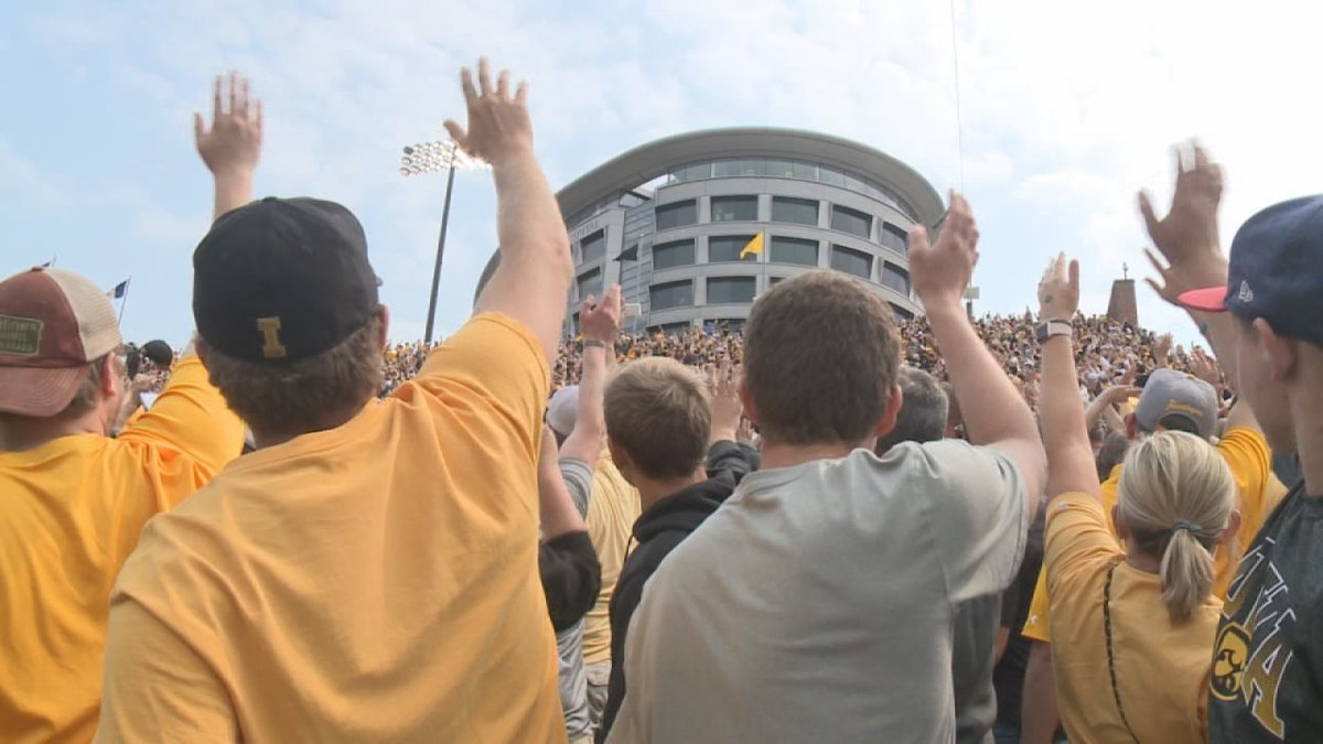In between the 1st and 2nd quarter of home football games, the near 70,000 at Kinnick wave to...