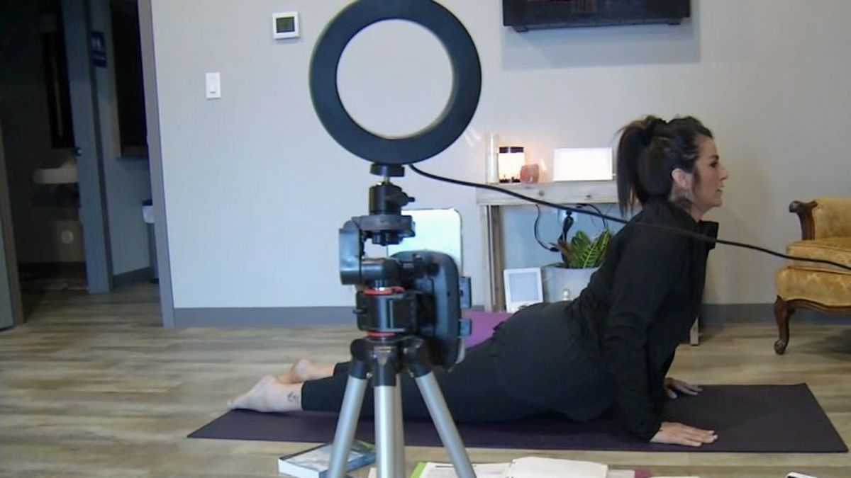 Dusty Swehla leads a yoga class online for people recovering from addiction during times of increased isolation. (Scott Saville/KCRG)