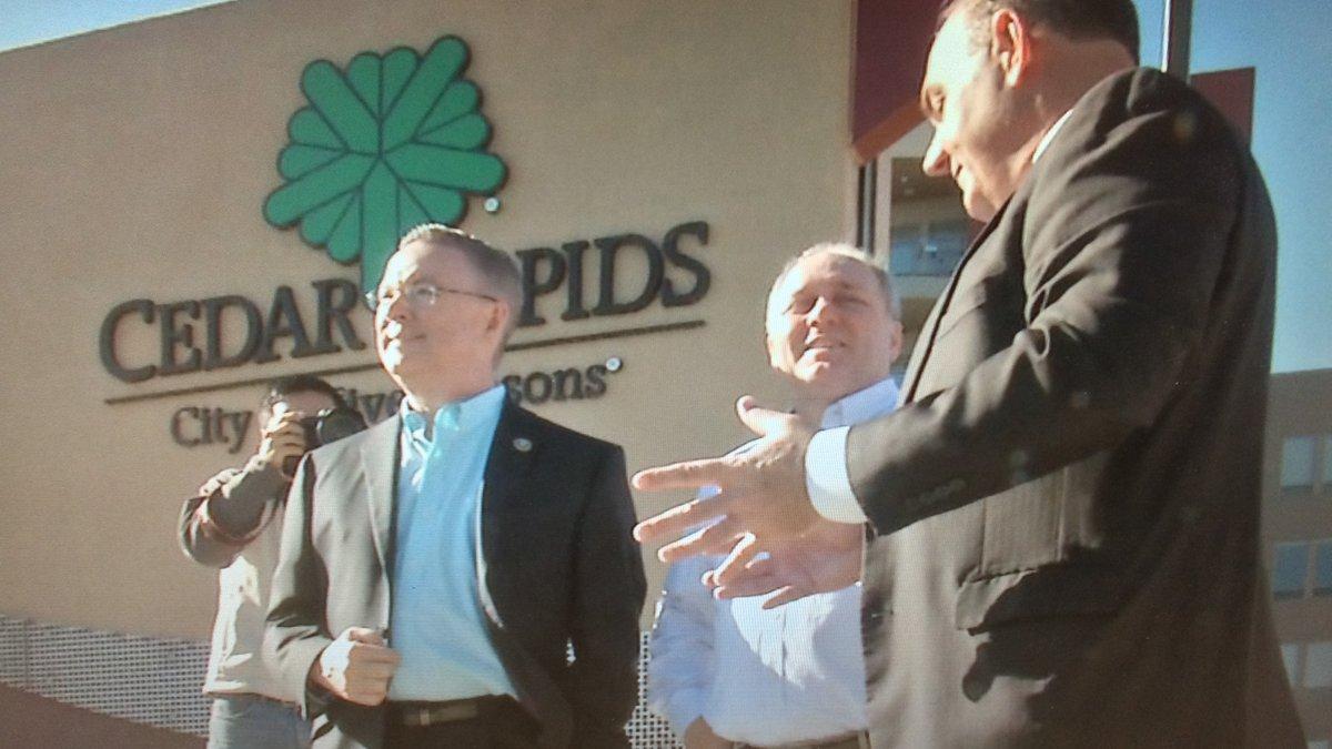 Cedar Rapids Mayor Ron Corbett talks with Rep. Rod Blum (left) and Rep. Steve Scalise (R)...