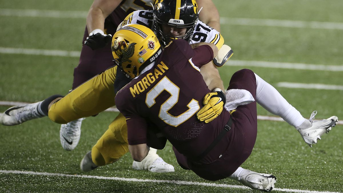 Iowa defensive lineman Zach VanValkenburg (97) sacks Minnesota quarterback Tanner Morgan (2)...