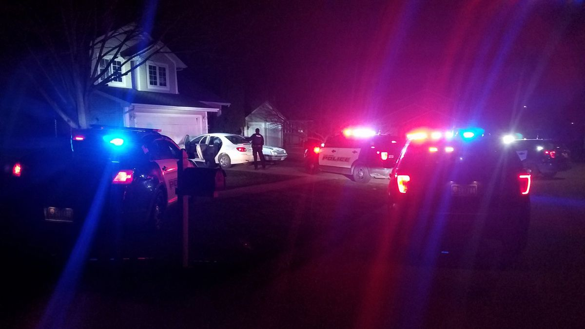 Several Cedar Rapids Police vehicles surround a car that allegedly led them on a short pursuit...