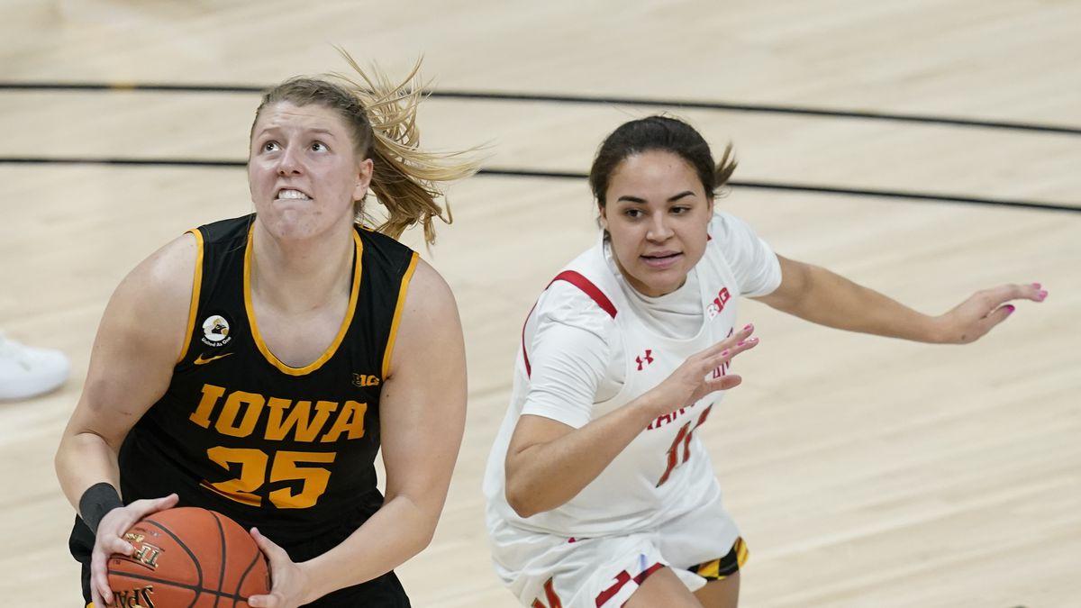 Iowa's Monika Czinano (25) shoots against Maryland's Katie Benzan (11) during the second half...
