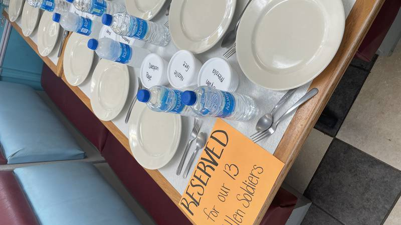 Tootsies in Vinton set aside a table with ice cream cups to the 13 military members killed in...