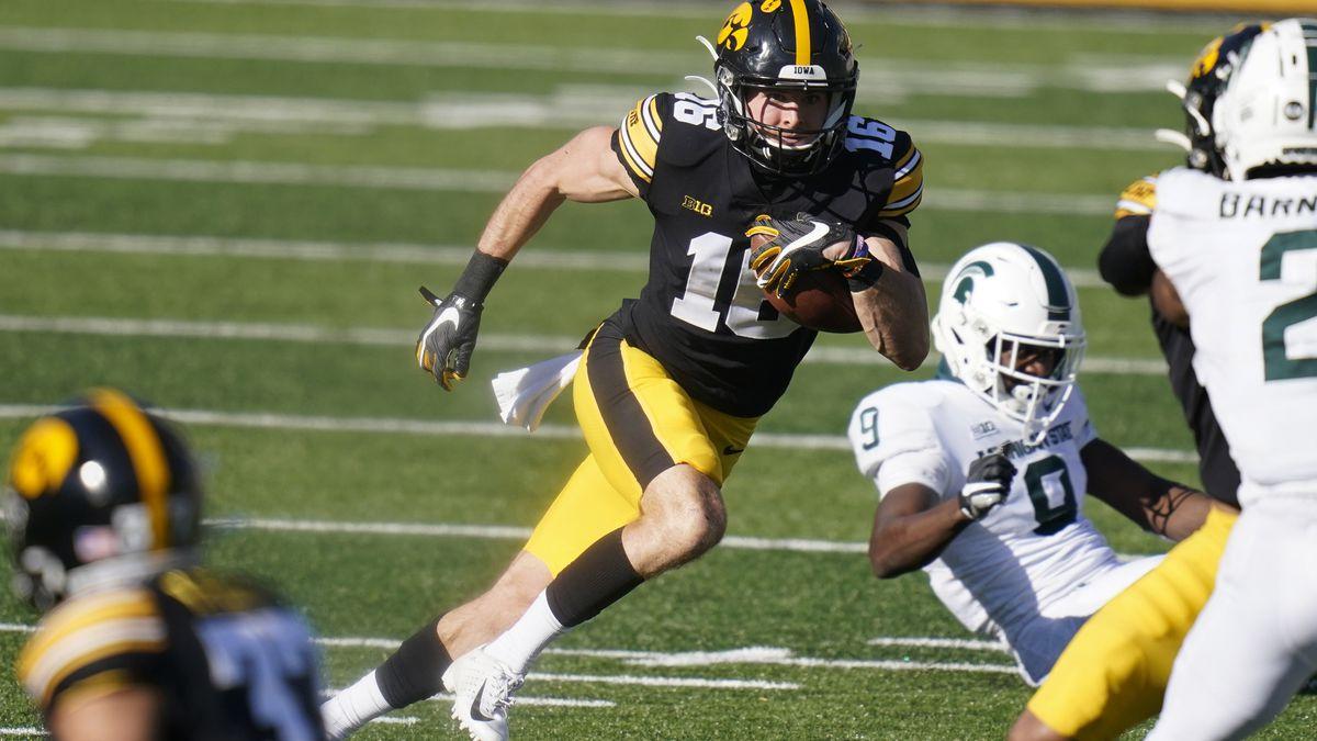 FILE - In this Saturday, Nov. 7, 2020, file photo, Iowa's Charlie Jones returns a punt during...