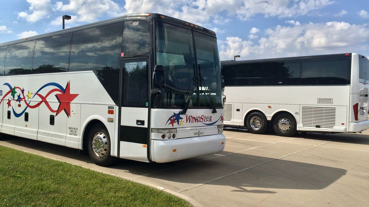 The 380 Express bus service between Iowa City and Cedar Rapids will use newer deluxe motor coaches.  One such motor coach, in the background, was just delivered on Monday.
