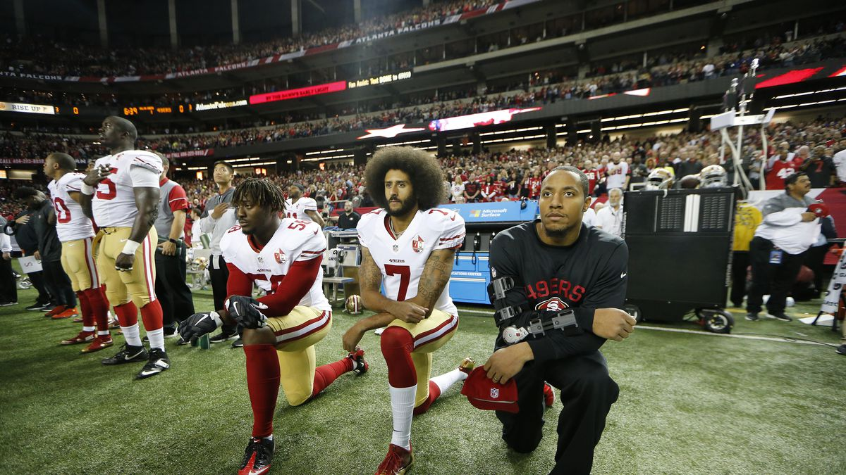 San Francisco 49ers quarterback Colin Kaepernick (7) and San Francisco 49ers outside linebacker Eli Harold (58) kneel during the playing of the National anthem before the first half of an NFL football game between the Atlanta Falcons and the San Francisco 49ers, Sunday, Dec. 18, 2016, in Atlanta. (AP Photo/John Bazemore)