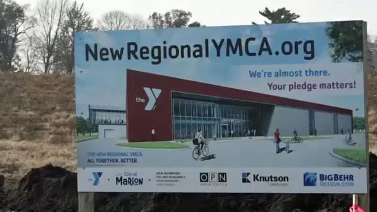 A sign with an architect's rendering of the YMCA facility under construction in Marion (Aaron Hosman/KCRG)