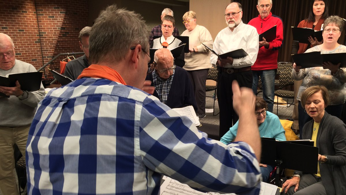 Steve Nurre leads the Together in Song chorus at Mercy Medical Center.  The group is composed...