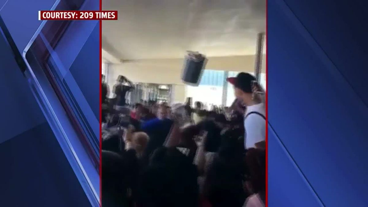 A high school in Stockton, California went on lockdown after a brawl between students and teachers; a trash can was thrown at responding police. (Source: KTXL/CNN)