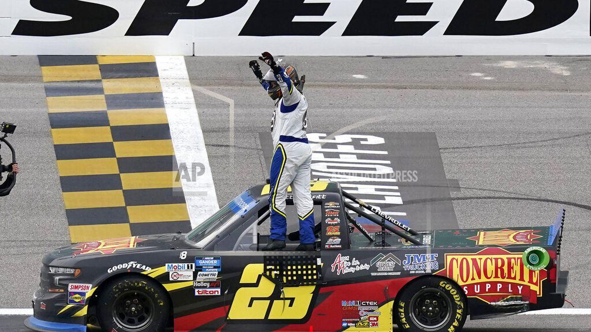 Brett Moffitt (23) celebrates after winning a NASCAR Truck Series auto race at Kansas Speedway in Kansas City, Kan., Saturday, Oct. 17, 2020. (AP Photo/Orlin Wagner)