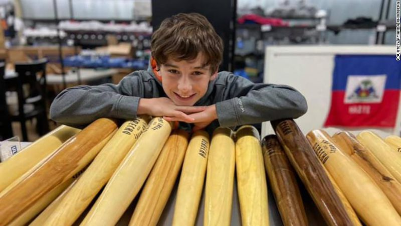 Tommy Rhomberg and his bats, which he carves out of trees brought down by a powerful derecho.