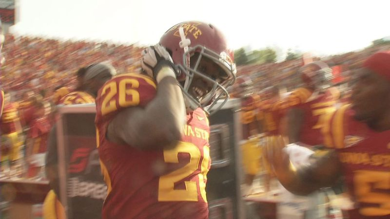 Deon Broomfield celebrates on the sidelines after an interception against Tulsa in 2012.