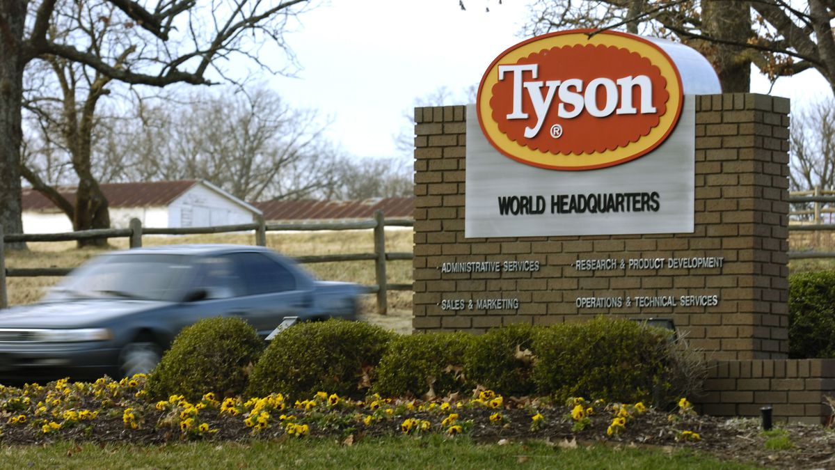 A car passes in front of a Tyson Foods Inc., sign at Tyson headquarters in Springdale, Ark., in...