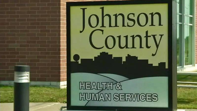 A sign outside of the Johnson County Health and Human Services building.