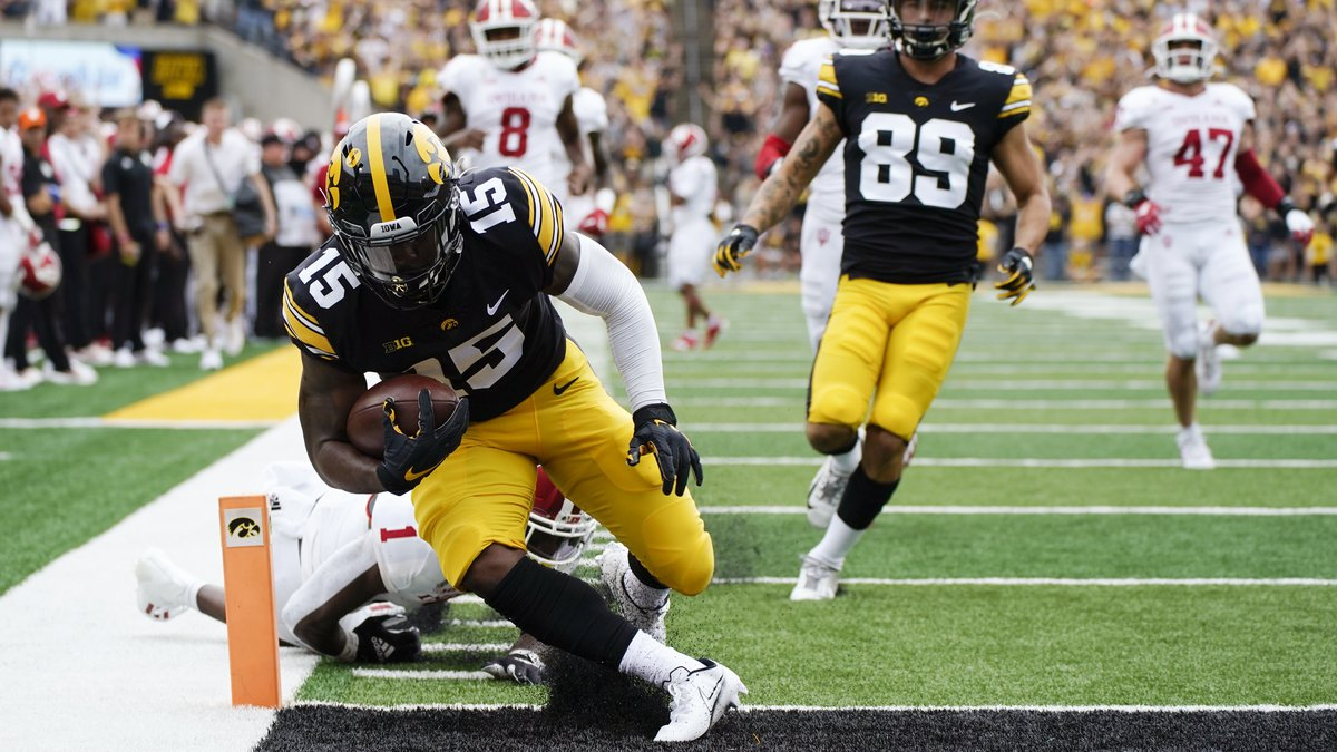 Iowa running back Tyler Goodson (15) scores on a 56-yard touchdown run during the first half of...