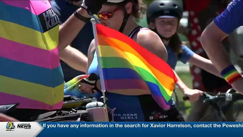 Cyclist bike for pride in Cedar Rapids