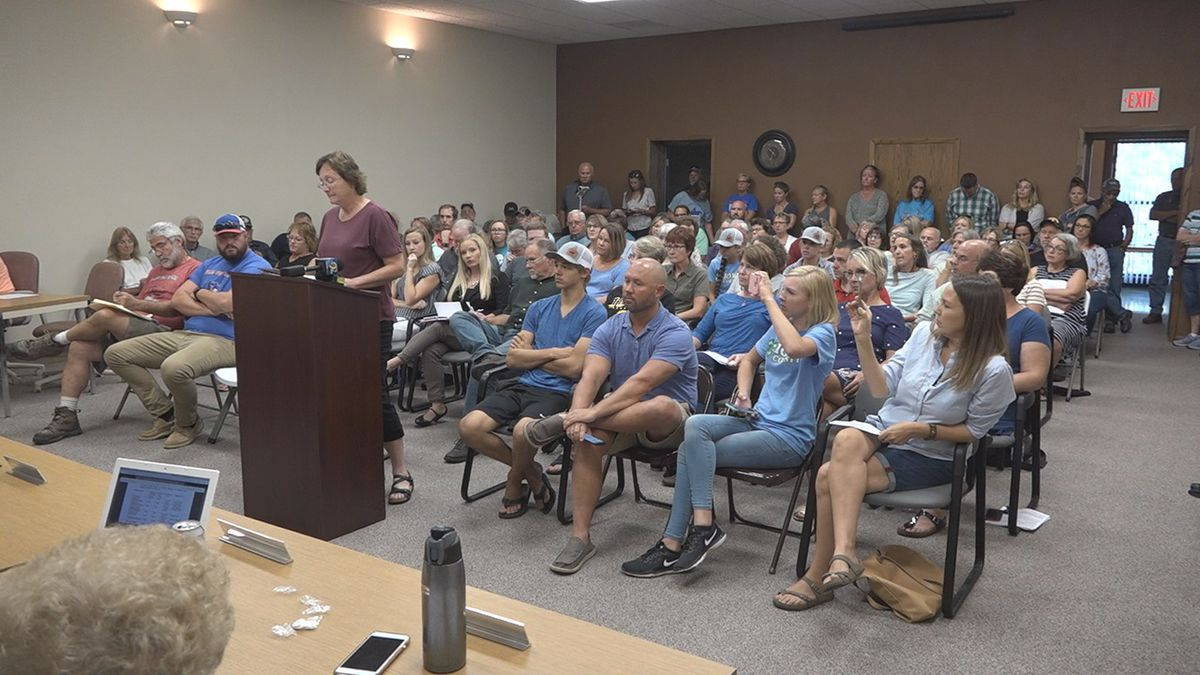 Mary Miller (at podium) speaks to the Iowa County Board of Supervisors at the East Annex Building in Marengo on Friday, August 23, 2019. More than 40 people spoke at the meeting discussing a potential wind ordinance in the county. (Aaron Scheinblum/KCRG)