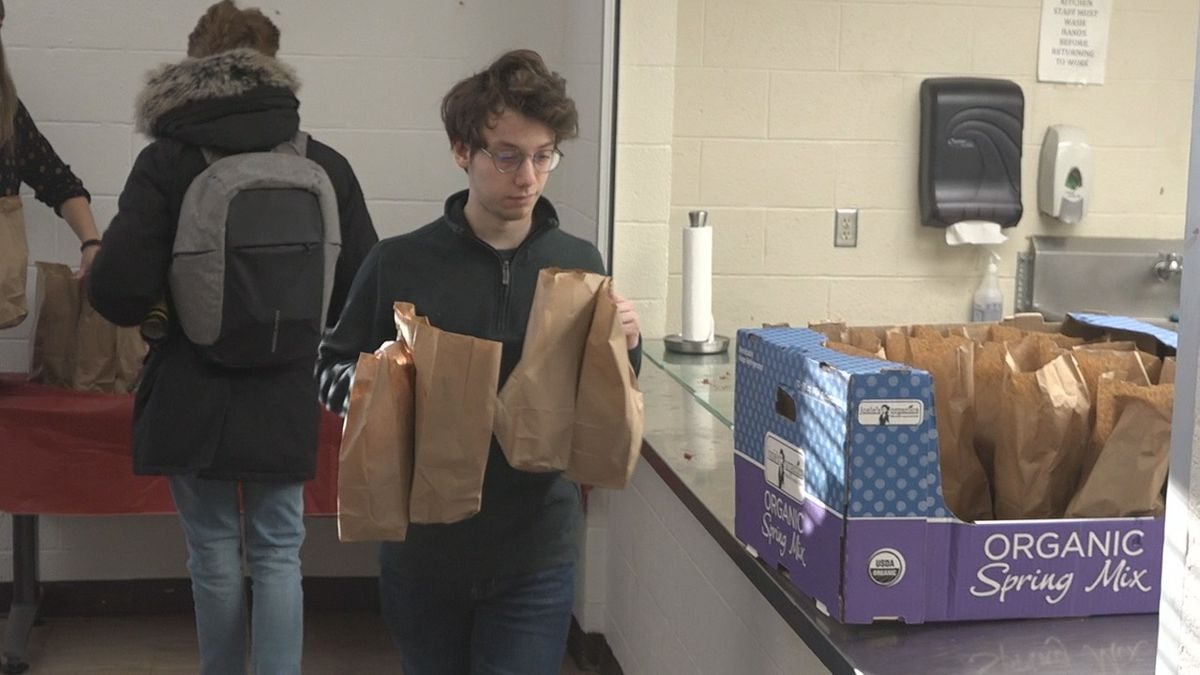Students at the University of Iowa Hillel fill up boxes with meals to bring to the Shelter House on Monday, Jan. 20, 2020 in honor of Dr. Martin Luther King, Jr. Day. (Aaron Scheinblum/KCRG)