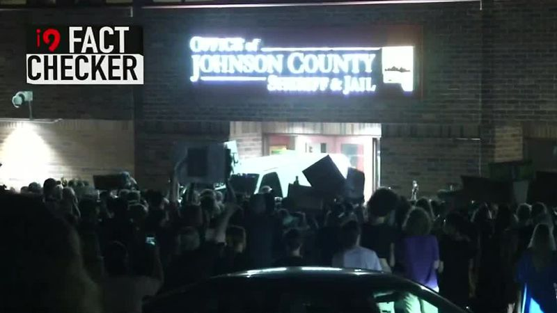 Protesters gather outside of the Johnson County Jail.