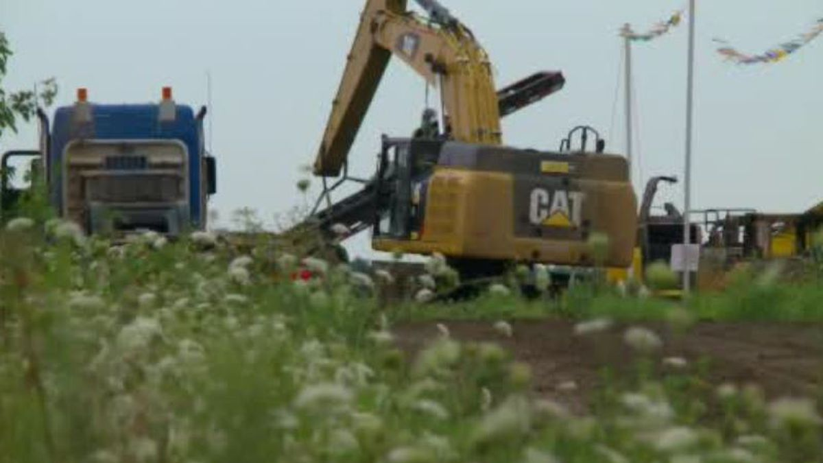 Replacements for the bulldozer and excavator destroyed by fire arrived a day after the incident...