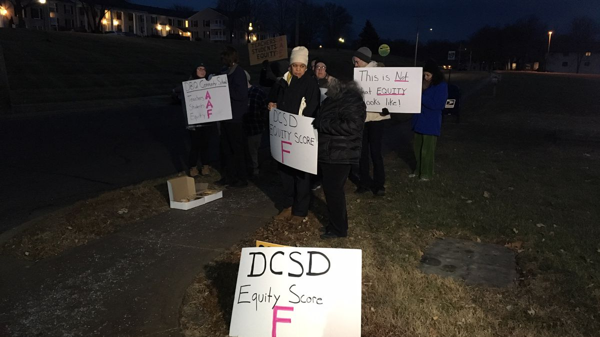 """Parents and others gather outside of the Dubuque Community School District offices on Wednesday, Dec. 19 to give the District an """"F"""" for addressing equity in the schools. (Allison Wong, KCRG-TV9)"""