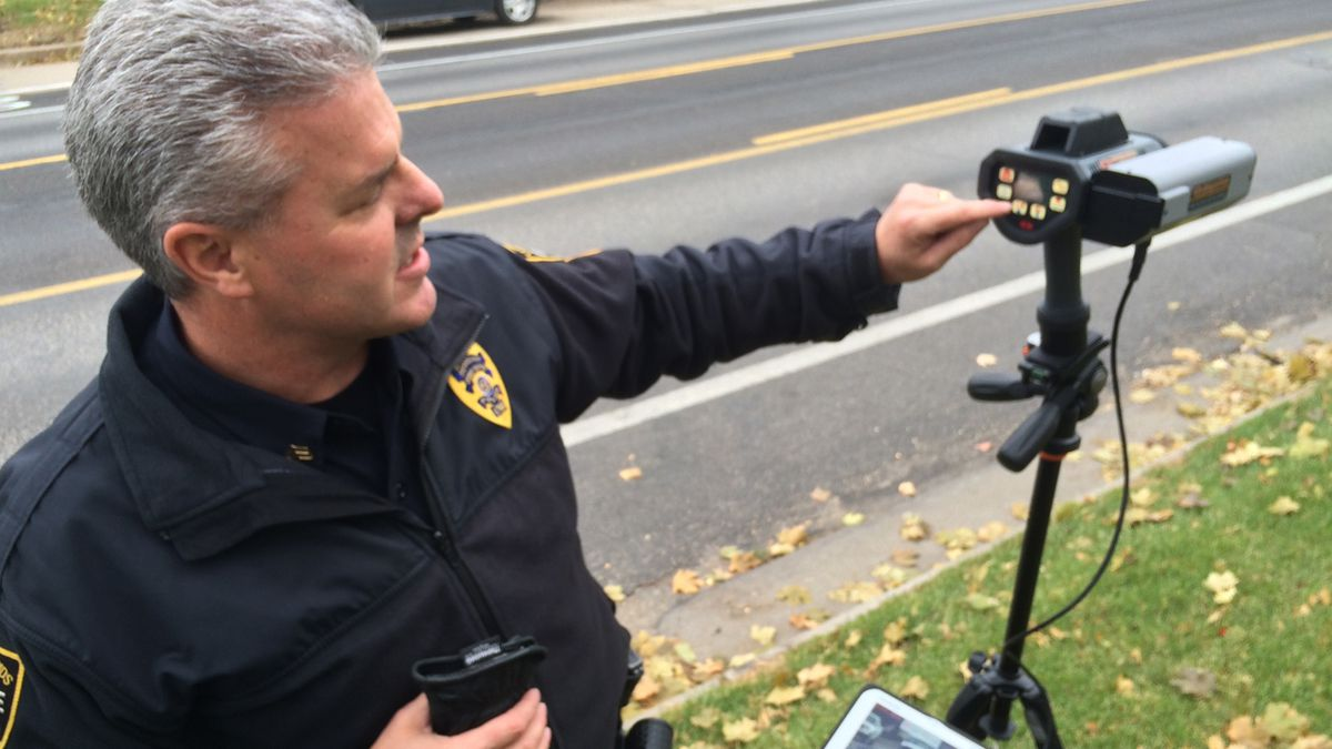 Sgt. Mike Wallerstedt demonstrates the departments new DragonCam in front of the Cedar Rapids...