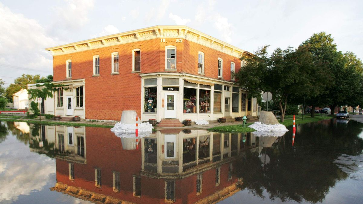 Little Bohemia is reflected in floodwaters at the intersection of 14th Avenue SE and Third Street SE as the sun rises Wednesday morning, June 11, 2008, in Cedar Rapids. (Liz Martin/The Gazette/KCRG-TV9)