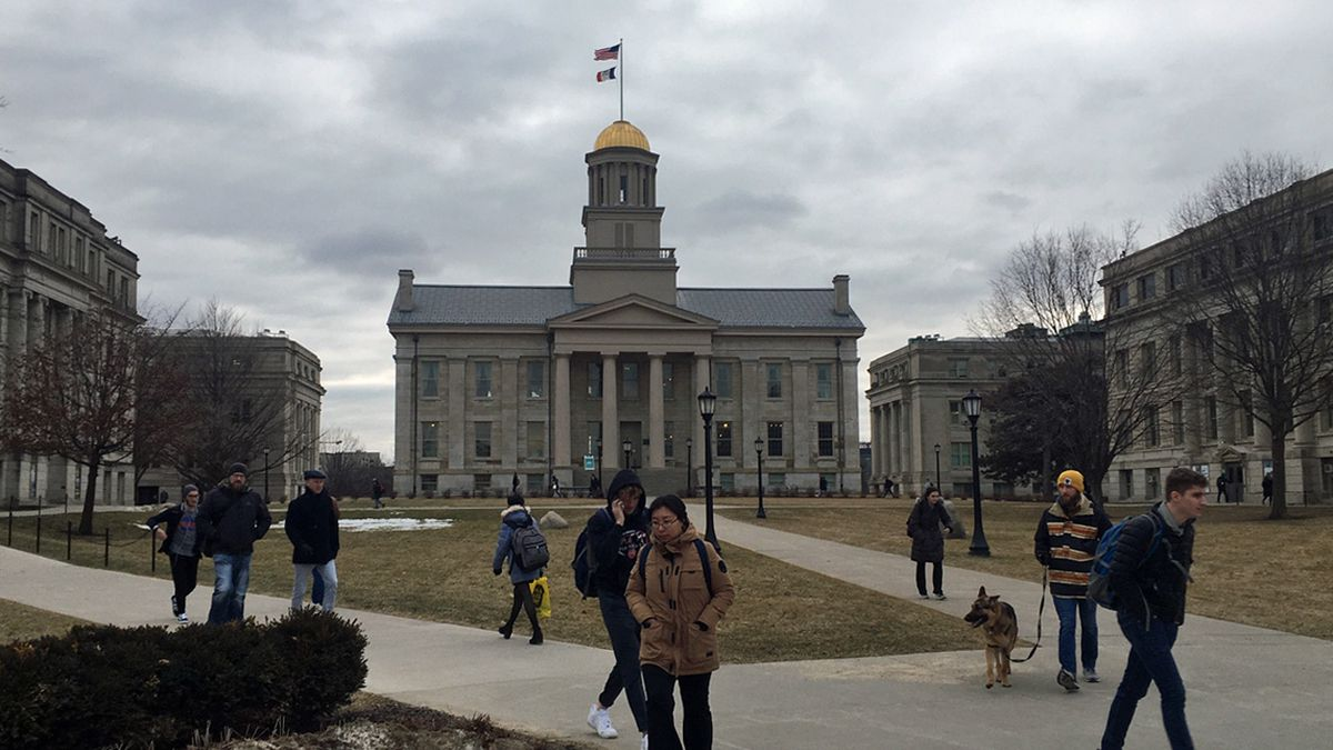 People walk on the Pentacrest on the University of Iowa campus in Iowa City on Tuesday, Feb. 25, 2020. (Mary Green/KCRG)