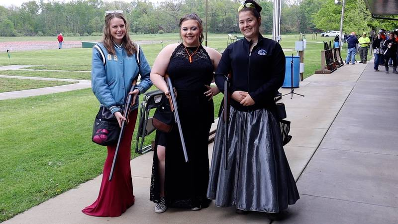 Friends create prom memory by trap-shooting in their dresses