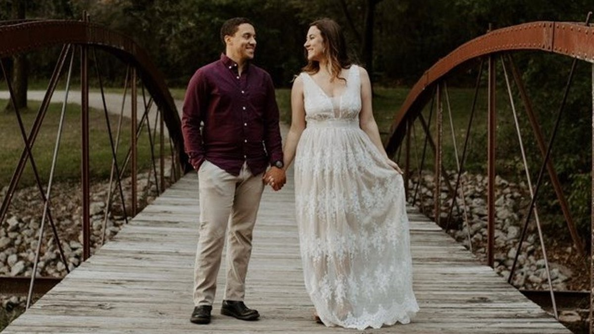 Kylee Howell and her fiance pose for engagement photos. Howell had her wedding dress and the...